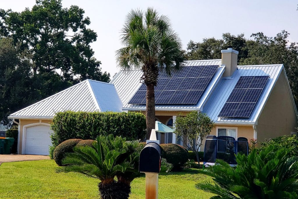 image of house with solar panels installed on roof