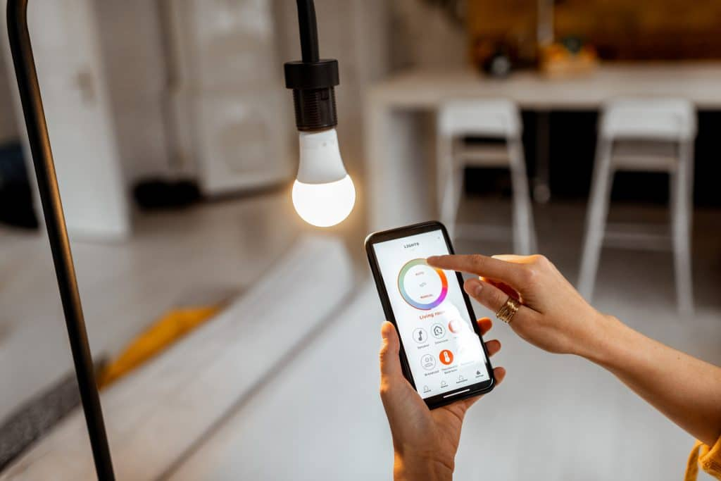 image of person monitoring energy usage using phone app