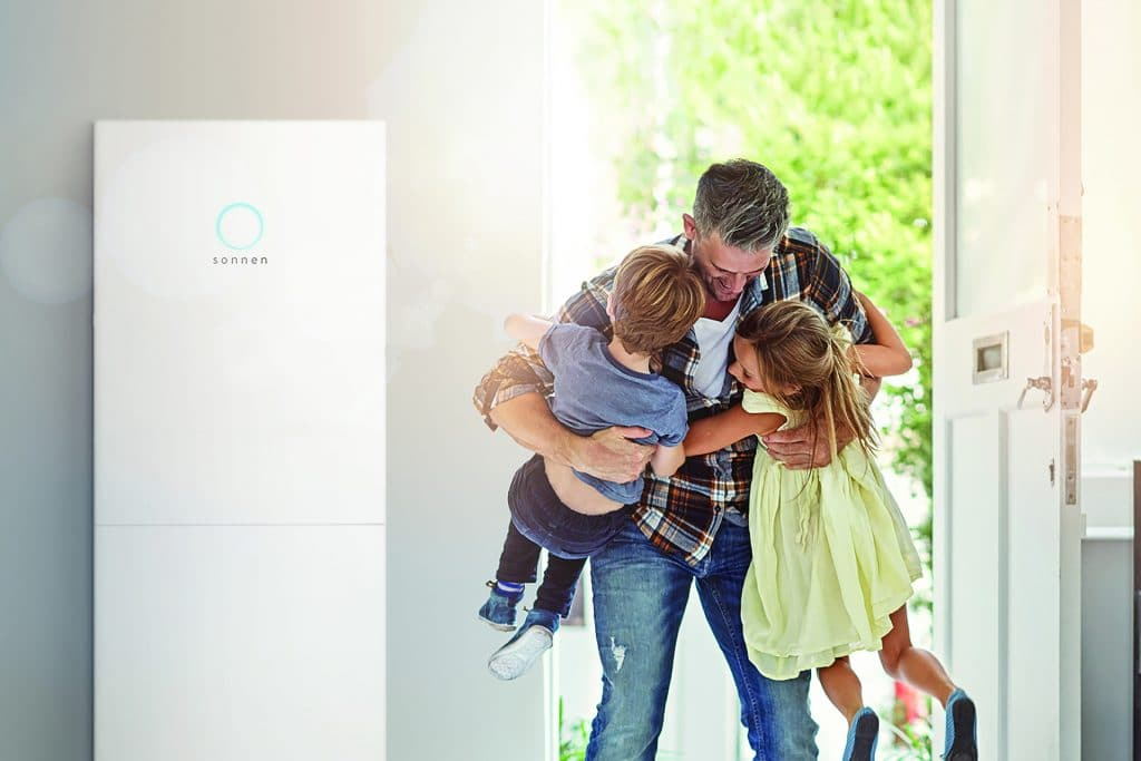 image of father and kids next to a sonnen battery