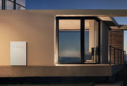 tesla powerwall installed on side of house