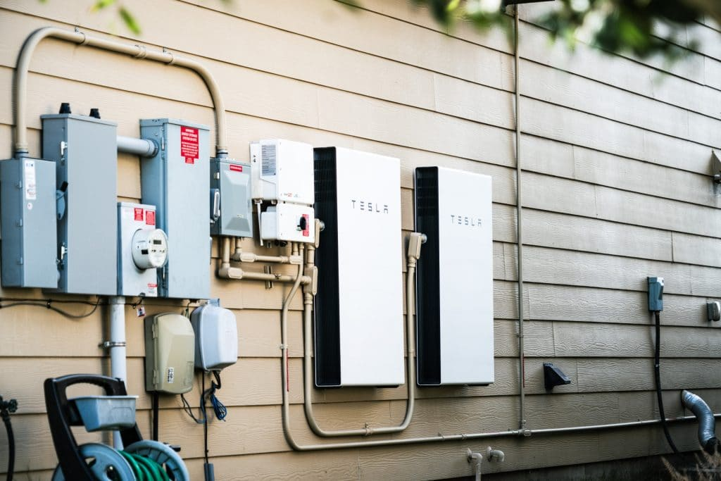 image of 2 tesla powerwalls attached to wall of house