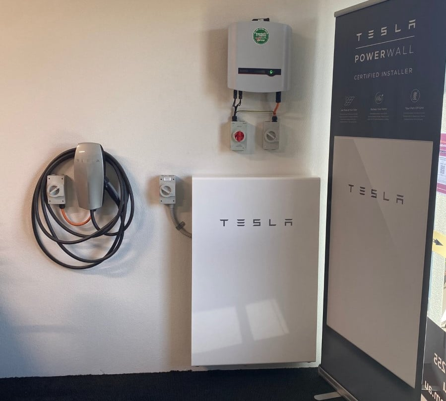 Image of a Supergreen Solutions Tesla Powerwall installation with an added EV charger